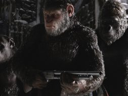 War-for-the-Planet-of-the-Apes-Caesar-holding-a-gun
