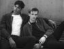 Fashion portrait of young handsome man young LGBT couple.