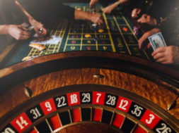 casino-theme-unrecognisable-gamblers-play-casino-money_95891-1035